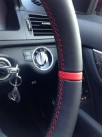 C63 AMG - Dark grey alcantara 9002 on sides, Smooth leather TopBottom + Red band at 12 oclock, Red stitching 2