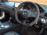 C63 AMG - Dark grey alcantara 9002 on sides, Smooth leather TopBottom + Red band at 12 oclock, Red stitching 3