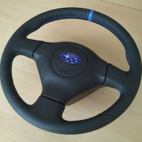 Impreza STI 05-07 - Black perforated leather + blue cente stripe at 12 o'clock, blue 1318 Stitching 1