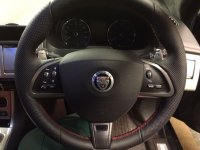 Jaguar XF,XK - thicker, thunb grips built up, perforated on the sides, nappa leather ( vertical joints), red stitching.