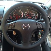 Mazda 6 - thicker, thumb grips added, perforated sides smooth top and bottom white stitching.JPG